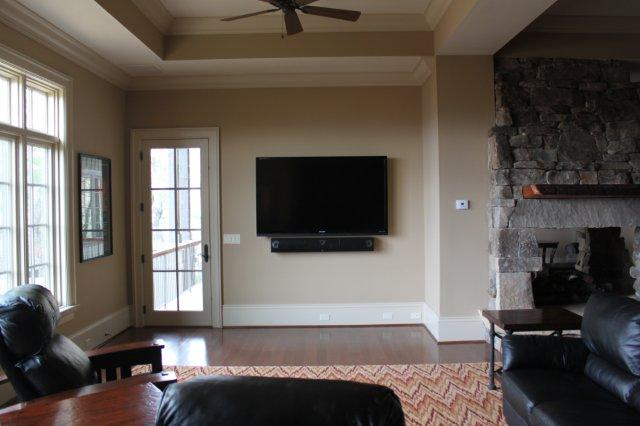 Lower level living room with 70in LED-LCD TV