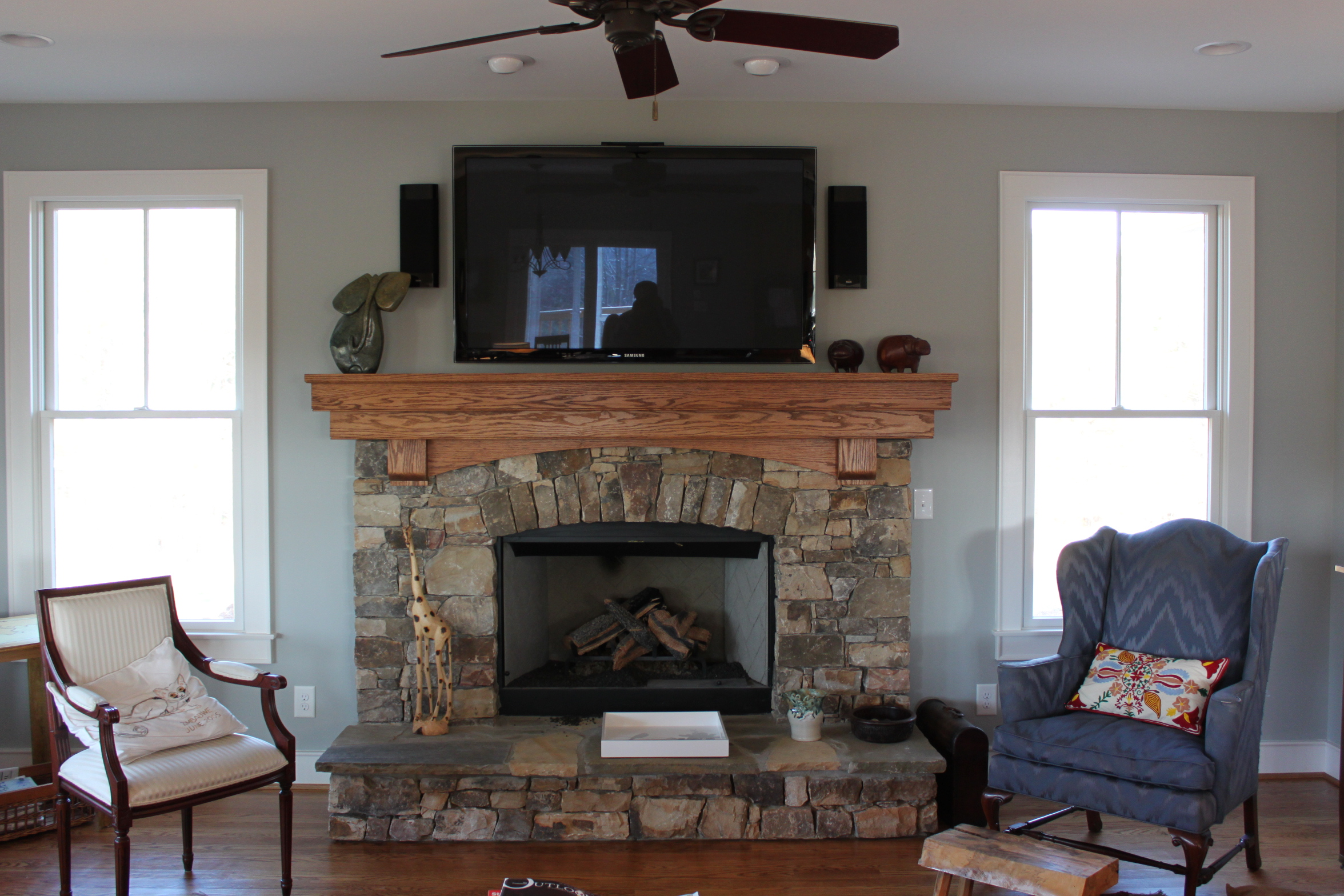 Fifty-five inch TV over fireplace